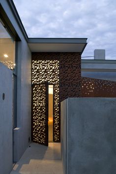 modern glass doors, overlay of perforated sheet of Corten steel, concrete home, contemporary desert design by Steven Holl Architects Wood House Design, Door Design, Exterior Design, Interior And Exterior, Architecture Details, Interior Architecture, Skylight Design, Porches, Steven Holl
