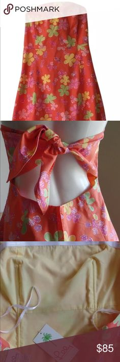 """Lilly Pulitzer Bustier Sundress Tie-Back Strapless Lilly's timeless """"Sabrina"""" design features a keyhole adjustable tie in the back to customize your ideal fit, with a boned bodice that helps to flatter your figure & maintain the shape of the dress. This fully-lined colorful, coral, cotton dress is ideal for those hot days when you want to feel effortlessly cool & chic. This lovely Lilly is in pristine condition, worn just a few times!! Concealed back zipper & Lilly's signature lace hem to…"""