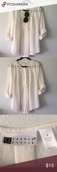 Sheer long-sleeve blouse Off-white Sheer long-sleeve button down blouse. In size small. Long sleeves button up for the roll-up sleeve look. Loose fitting. Scoop neck. Very cute with fitted jeans. Carole Little Tops Blouses