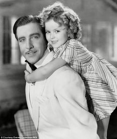 Vibrant: Shirley pictured aged seven in Curly Top with actor John Boles