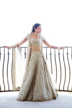 Shop this shiny & shimmering lehenga choli with heavy crystals work. Indian Bridal Outfits, Indian Bridal Lehenga, Indian Bridal Wear, Indian Dresses, Bridal Dresses, Gold Lehenga Bridal, Pakistani Bridal, Indian Clothes, Bridal Lehenga Collection
