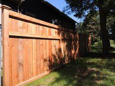 Custom 6' high cedar wood privacy fence with trim detail