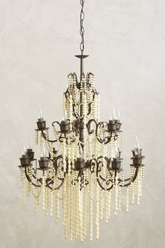 "Hand-Beaded Melange Chandelier Includes ceiling plate One light socket Hardwired for professional installation Brass, resin 40 watt max 115"" cord 41""H, 28"" diameter Imported Assembly not included with Unlimited Furniture Delivery"