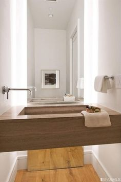 Contemporary Powder Room with Athens Grey Vein Cut Limestone, Wall sconce, Molding, Wood counters, Hardwood floors, Wood sink