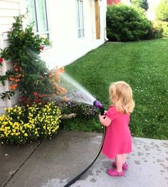 Helping water the flowers