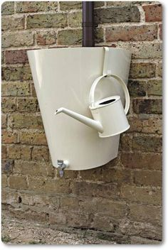 attractive rain barrel and watering can-much prettier than the trash can idea Outdoor Projects, Garden Projects, Outdoor Ideas, Water Barrel, Garden Solutions, Water Collection, My Secret Garden, Lawn And Garden, Rain Garden
