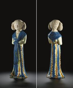 A rare blue, amber and cream-glazed pottery figure of a young girl - Tang dynasty (618-907)