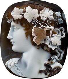 Bacchus Cameo, c.1810, Italy, Sardonyx cameo of Bacchus, dark curly hair garlanded with grapes and vine leaves, tied with ribbons falling onto his shoulder, wearing animal skin, one paw visible on left at neck, dark pelt on the right, facing in profile towards the left. Signed in Roman capitals on baldric MORELLI, for Nicola Morelli (1771-1838), Caroline Murat, Queen of Naples and Sicily, her gift to the Moore family, thence by descent.