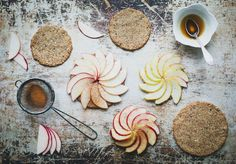 VEGAN APPLE & OAT TARTLETS  Crust  ½ cup gluten free rolled oats  ½ cup raw sunflower seeds  8 fresh soft dates, pitted  2 tbsp coconut oil, room temperature  a pinch of salt    Filling  4 tbsp almond butter    Topping  3 small red apples  ½ lemon, juice  1 tbsp maple syrup or runny honey  1 tbsp cold pressed olive oil  2 tsp ground cinnamon