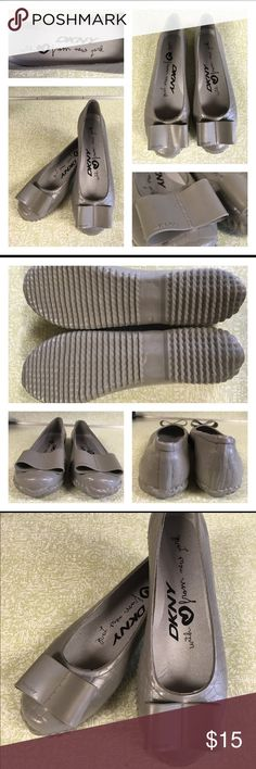 NWOT DKNY Rain Beaux Flats Rain Shoes Not a rain boot kind of gal. Try these. Fun flats that could get you thru the rain and thru to semi casual work day. New with out tags. No box. One blemish on rubber see yellow arrow. DKNY Shoes Flats & Loafers