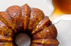 One of my favorite pie alternatives is bundt cake A hearty spice-filled bundt cake made from grated apples and toasted nuts, then soaked in whiskey syrup, defies the cliché of Thanksgiving dessert, yet keeps well within its harvest-time paradigm Plus, a bundt cake, which is really just like an oversize muffin baked in a fancy pan, is easy to whip up