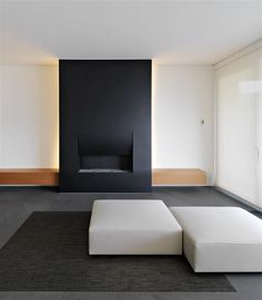 Black, sculptural 'folding' fireplace. Migani Attic Interior by Victor Vasilev.