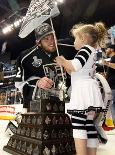Jonathan Quick and his daughter. This is awesome. He was a reading royal.. And a stand up guy