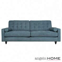 The angelo:HOME Laura sofa was designed by Angelo Surmelis. The Laura sofa features a button tufted back and rolled arm bolster pillows.
