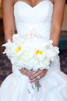 LOVE an all white bouquet.  That little pop of yellow makes it a show stopper.