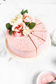 This delicious from scratch Homemade Fresh Strawberry Cake made with fresh strawberries has no artificial colors or flavors. Paired with fluffy strawberry cream cheese frosting, this is the perfect Mother's Day cake!