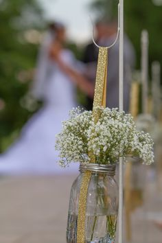Baby's breath in mason jars hung with gold ribbon - Gorgeous rustic ceremony under our Pergola | Decor by A Garden Party Florist & Photo by Salex Photography