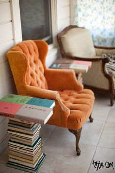 Look at this awesome end table! Love the color of then tufted chair.