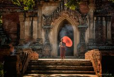 Little monk with red umbrella  -