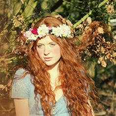 flowers in her hair...hair stuck in the tree? pretty nonetheless ;)