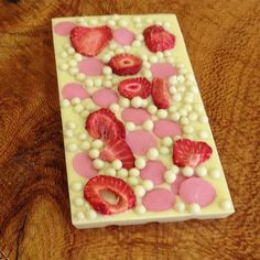 Creamy White Chocolate with Freeze Dried Strawberries. Strawberry Buttons & White Chocolate Crispearls. Any Strawberries Cream lovers dream!