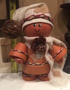 "Terra cotta ginger bread man with burlap and raffia. 4"" centre pot #christmas #crafts #terracottagingerbreadman"