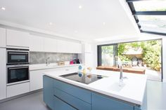 Side Return Extension on a Victorian Terraced House, Kitchen Extension in Highbury, N5, Greater London, Sliding Glass Patio Doors, All-Glass Roof, Velux Roof Light, Flat Roof, Structural Glazed Roof, Wraparound Extension, Kitchen Extension Ideas, Rear Extension, Kitchen Island