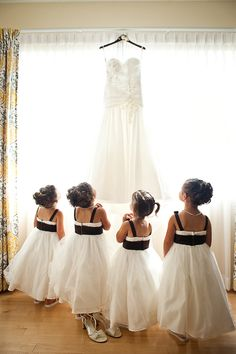 flower girls admiring wedding dress- adorable- photo by Diana Deaver Weddings