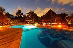 Caribbean Pool at Dusk. - Mahekal Beach Resort.