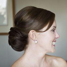wedding hair bun | Image via the Powderoom / Photography by Studio Impressions
