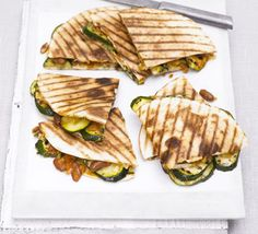 Grilled courgette, bean & cheese quesadilla. For a tasty Mexican-style supper, fold up some tortilla pockets and cram with veggies, pinto beans and oozing melted cheddar