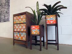 "Handmade modern dresser and planter set. Collaboration with furniture maker Jamie Coxon and fine artist Burl Vreeland. Created on the central coast of california, spring 2015. These vibrant colors are a bautiful addition to the walnut case. The planter set holds a 6""X6""X6"". The front panels of these pieces are hand painted and fiberglassed in the same process of surfboard design."