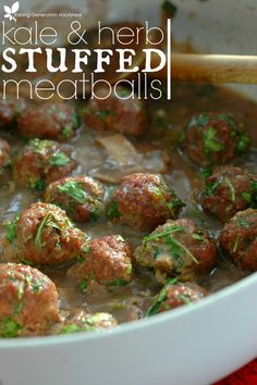 Kale & Herb Stuffed Meatballs :: Superfood packed, and full of flavor! These kale & herb stuffed meatballs is a dinner menu must have!