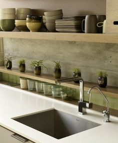 Concrete - Backsplash Ideas - Sealed and waxed. I like the placement of shelves too :)
