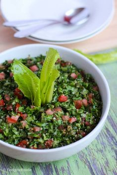 This traditional Lebanese Tabbouleh Salad recipe is a fresh Mediterranean appetizer made with bulgur, parsley, mint and very finely chopped vegetables. Try it as a healthy vegetarian summer side dish for lunch or dinner #salad #sides #summer