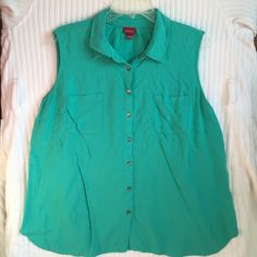 Medina XXL teal sleeveless top 100% rayon, button down, sleeveless. Teal with brassy little buttons. Pretty and in great condition!  WE ARE ON VACATION UNTIL FEB. 7. ALL PURCHASES WILL BE SHIPPED OUT THEN. PLEASE BE OK WITH THIS BEFORE PURCHASING. Merona Tops Button Down Shirts