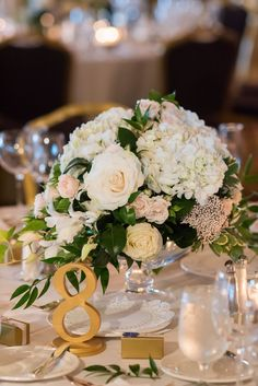 ivory, blush, with lots of lush greens oblong wedding centerpieces + gold table numbers