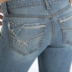 (BACK) The BLAKE has accessorized! Studs line the left front pocket, and continue up onto the back center belt loop. The folded-over back pocket corner and heavy embroidery in matching charcoal and stone threads, hand sanding, permanganate, and whiskers give the last bit a glam the jeans need. CB41554071 IND