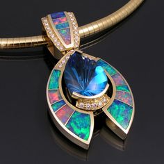 Australian opal pendant with blue topaz and diamonds _ The center stone is a spectacular carat shell fantasy cut Swiss blue topaz _ Australian opal inlay jewelry is our specialty! Opal Jewelry, Jewelry Box, Vintage Jewelry, Fine Jewelry, Unique Jewelry, Handmade Jewellery, Opal Necklace, Jewelry Stores, Jewelry Websites