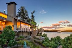 * Beautiful Architecture : Location: Bainbridge Island, Washington *  This 1979-built home designed by Hal Moldstad, the noted Northwest modernist who also built homes for Microsoft co-founders Bill Gates and Paul Allen, offers a top-notch waterfront refuge. Sold for exactly the ask price, the 4,765-square-foot abode offers sweeping views of the Puget Sound, vaulted ceilings, a stone fireplace, spa-style bathroom and sauna, tons of wood detailing, and a private beach.