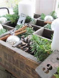 Old crate with ornaments & greenery..