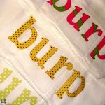 """Very cute!!  I love the word applique idea, on different style cloth.  I don't like the idea of making a """"handmade"""" burp cloth out of a purchased burp cloth/diaper."""