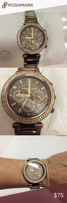 """Michael Kors Parker Chocolate Ladies Watch Michael Kors Parker Chocolate Ladies Watch is in very good used condition but NEEDS A NEW BATTERY. Rose gold tone stainless steel case with espresso stainless steel bracelet. Bezel set with crystals. No additional links available, measures appropriate 6.5"""" around wrist. Michael Kors Accessories Watches"""