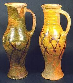 Highly decorated 13th -14th centuries Common name Brill/Boarstall ware, Buckinghamshire Class Baluster jugs Height left, 410mm right, 400mm Identifier PW08 Production in west Buckinghamshire