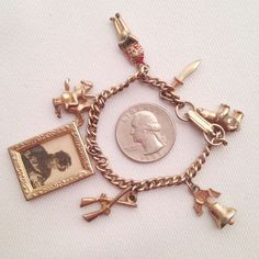 Great painted brass Davy Crockett/Fess Parker charm bracelet. Miniature 1 1/8in x 7/8in framed black & white photo, knife, Indian Chief..