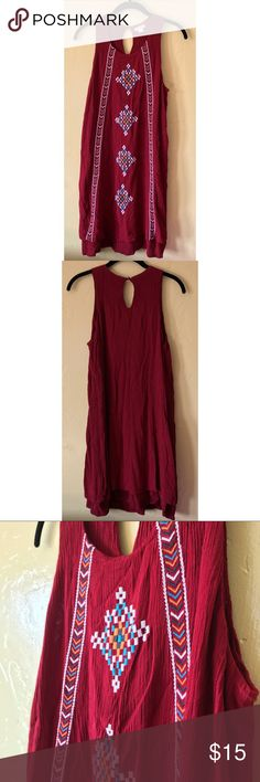 ✨SALE✨ Burgundy Tribal Print Sundress Gently used. No damage. Smoke free home.  Cute dark red crepe material dress. Embroidered tribal pattern on front. Double layered with attached slip underneath. Keyhole buttoned back.  ❤️ Feel free to make me an offer -- All reasonable offers will be considered!  ❤️ Bundle & save! Purchase 2 or more items from my closet and receive 25% off!  ❤️ Unfortunately no offers will be accepted on bundles. Thanks for understanding!  xoxo - Ashley Faye Xhilaration…