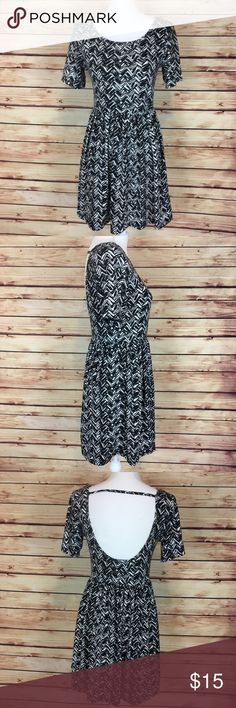 "Forever 21 Black White Chevron Scoop Back Dress M Forever 21 dress. Black and white chevron. Short sleeve. Scoop neck. Low cut back. Elastic waist. Medium.  Excellent preowned condition with no flaws.  Measurements are approximately: 32"" bust, 24"" waist, 44"" hips, and 32"" length.  93% polyester 7% spandex.  No trades. All items come from a pet friendly home. Bundle to save! Forever 21 Dresses"