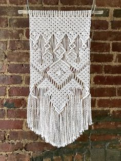 Macrame wall hanging made with natural cotton cord. Made to order. Available in locally sourced natural wood or standard smooth dowel. Please allow days to create and ship. 12 wide x 16 long Thank you Macrame Wall Hanging Patterns, Macrame Art, Macrame Projects, Macrame Patterns, Tapestry Wall Hanging, Boho Cushions, Macrame Curtain, Décor Boho, Boho Decor