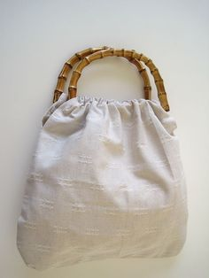 This bag is easy peasy to make. Use the pattern on Greenie Dresses for Less to make your own bag.