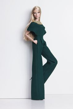 A flared jumpsuit in deep emerald, collar embellished with rhinestone.